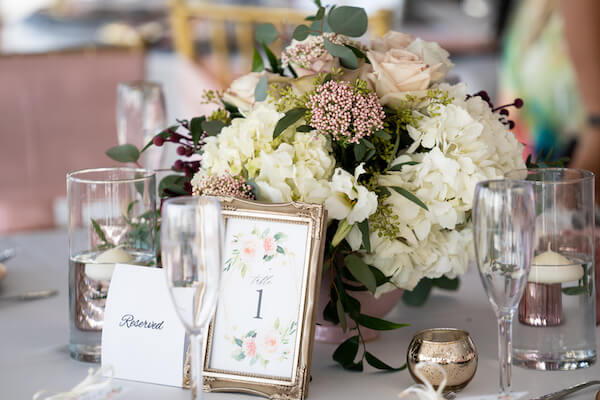 Sirata Beach Resort wedding reception - Coconut Palm Pavilion - Coconut Palm Pavilion wedding reception - pink and white wedding centerpieces - gold table number frames - rose gold votive candles- rose gold wedding decor