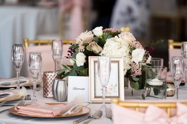 pink and white wedding centerpiece - pink satin napkins - gold chivari chairs - pink chair sashes - gold charger plates - custom menu cards - Coconut Palm Pavilion wedding reception - Sirata Beach Resort wedding reception