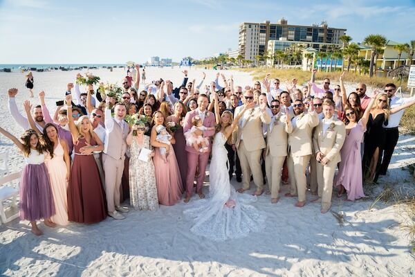 Saint Pete Beach wedding - bride and groom on beach with wedding guests - photo of all wedding guests - wedding guests on beach - Sirata Beach Resort wedding photos