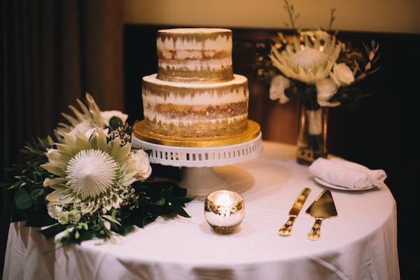 naked wedding cake - naked wedding cake with gold leaf - two tiered gold foiled wedding cake