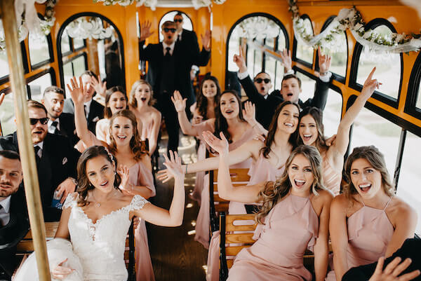 Florida wedding – Saint Petersburg Florida wedding – Saint Petersburg wedding – Greek wedding - wedding party on the way to church - wedding party on trolley - bride with wedding party on the way to ceremony