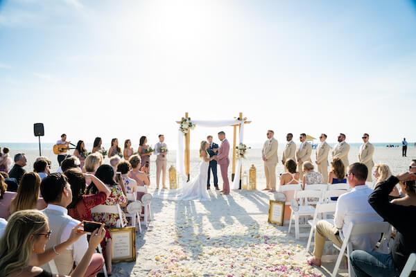 beach wedding ceremony - Sirata Beach Resort wedding ceremony - Saint Pete Beach wedding ceremony - pink and white beach wedding - bride and groom on beach = bride and groom exchanging wedding vows
