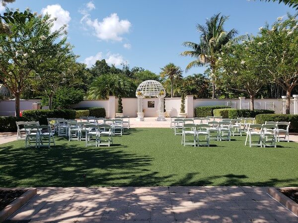 Outdoor wedding ceremony - socially distant wedding ceremony - physically distant outdoor wedding ceremony - Pinellas Botanical Gardens intimate wedding ceremony -safety protocols for weddings during covid