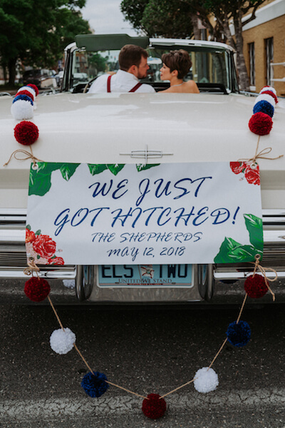 special moments event planning. - bride and groom driving off in a vintage white convertible - Saint Petersburg Florida wedding - vintage Americana wedding