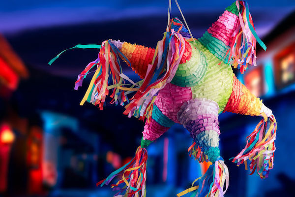 hiring a wedding day coordinator is like swinging blind at a piñata - a brightly colored piñata