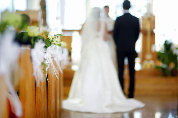 bride and groom standing in church ready to be married