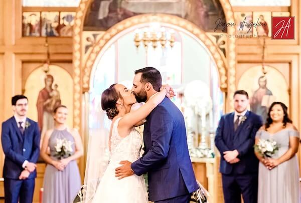 bride and groom kissing after a socially distant Greek Orthodox wedding in Tampa