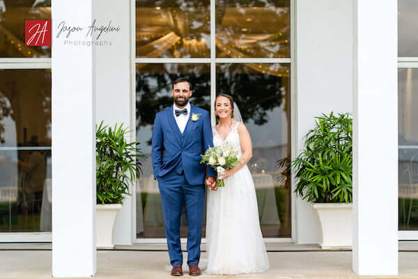 bride and groom pose for photos out front of Tampa Garden Club