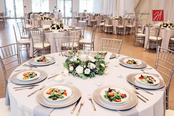 Tampa Garden Club wedding reception set with tables six feet apart
