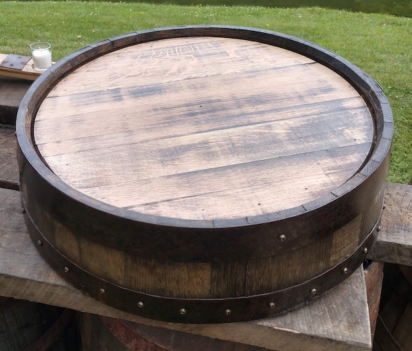 slice of a rustic wine barrel as a cake stand - Tampa weddings – wedding cakes – cake stands – displaying your wedding cake