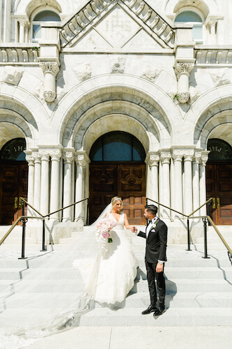 Bride and Groom on the steps of Sacred Heart Catholic Church in Tampa