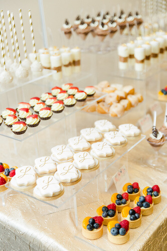 bite sized desserts on clear lucite risers