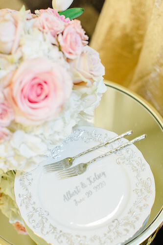 vintage inspired cake plate with bride and grooms names along side Mr. and Mrs. forks