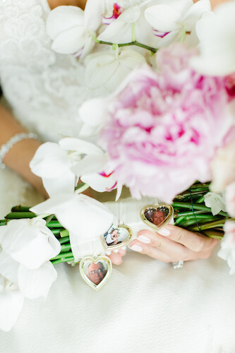 pink and blush bridal bouquet with personal family photo lockets