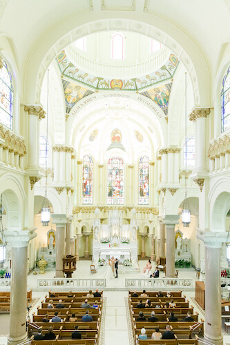 Socially distant wedding with assigned seating at Sacred heart Catholic Church in Tampa