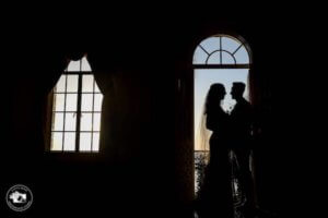a shadowy photo of a bride and groom at the Powel Crosley Estate in Sarasota