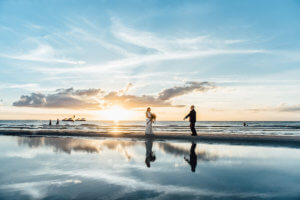 couple walking on Clearwater Beach at sunset