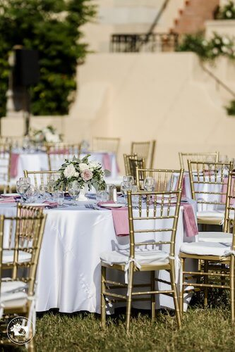 outdoor wedding reception with gold chivari chairs and pink and white decor at Powel Crosley Estate
