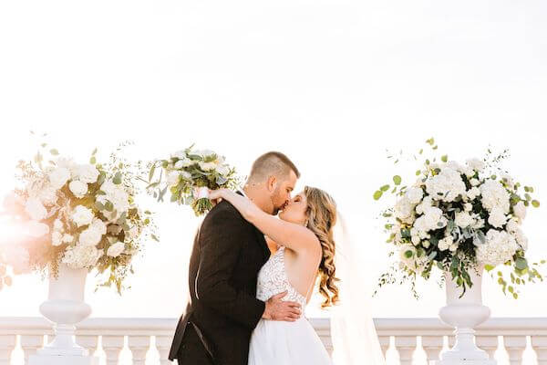 bride and groom kissing at the end of their wedding ceremony on the Sky Terrace at the Hyatt Clearwater beach