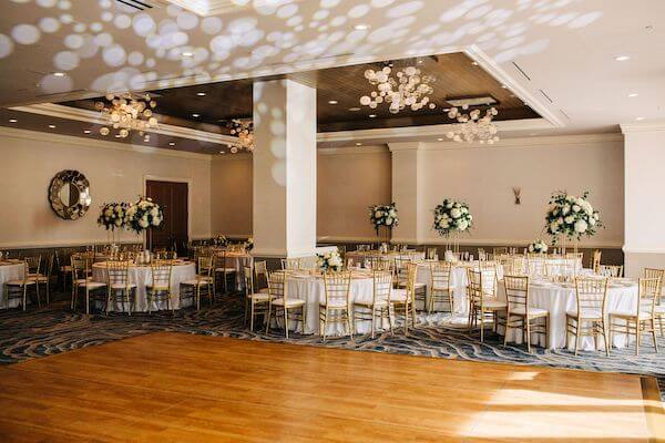 gold and white reception decor at the Bellaire Ballroom at the Hyatt Clearwater Beach