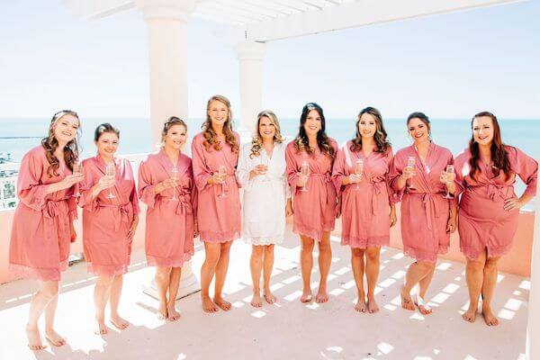 bride with her bridal party sipping champagne at the Hyatt Clearwater beach