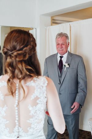 Father of the bride crying when he sees his daughter for the first time