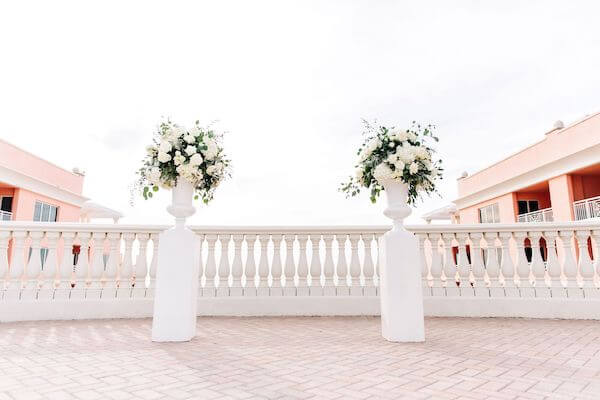 two white urns filled with white flower on the Sky Terrace