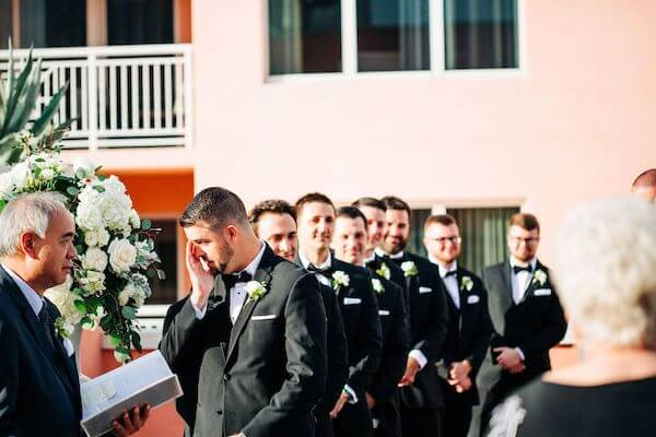 groom tearing up waiting for his brides arrival
