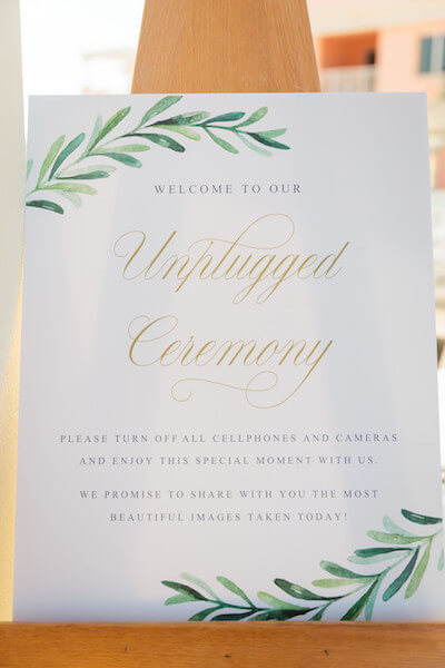 custom designed sign for a wedding ceremony asking guest to unplug and enjoy the wedding