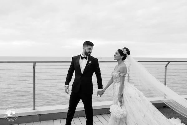 Bride and groom on the terrace at the Opal Sands Resort on Clearwater Beach