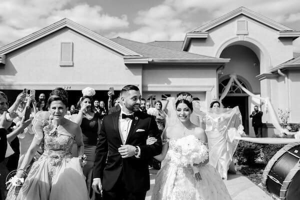 bride being escorted to her fairytale Clearwater Beach wedding