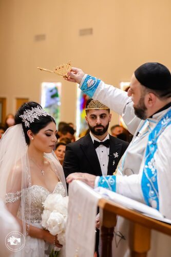 Bride and groom during their Syriac Orthodox crowning ceremony