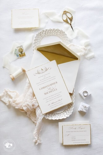 Flatlay photos of brides invitations and accessories