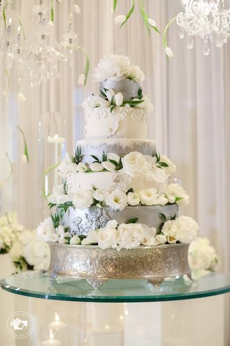 five tiered white and silver wedding cake at the Opal Sands Clearwater Beach