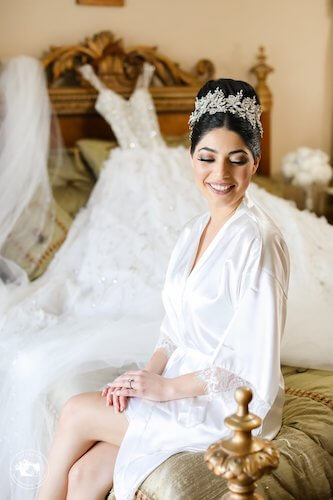 fairytale bride posing for photos in white robe