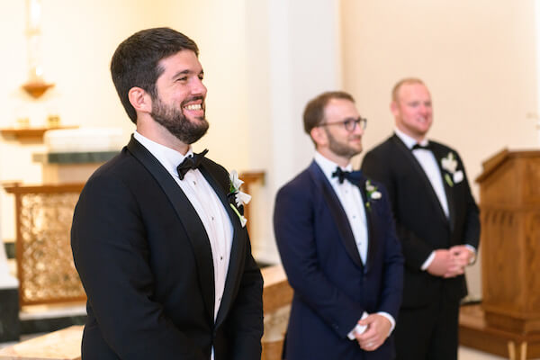 Smiling groom waiting on his bride's arrival at Saint Mary's church in Saint Petersburg