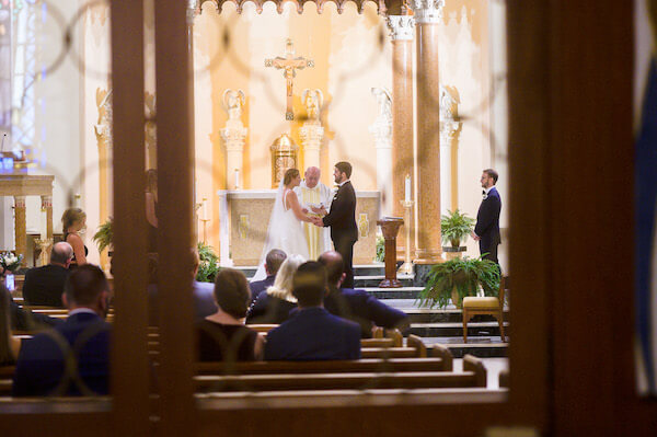 Bride and groom exchanging wedding vows during their Saint Pete wedding