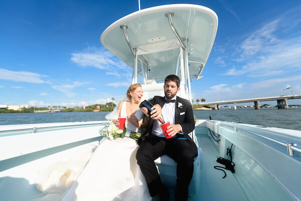 bride and groom on a boat headed to their wedding reception after their Saint Petersburg wedding ceremony