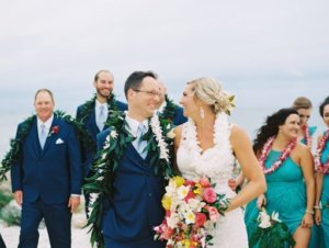 bride and groom on clearwater beach wearing Hawaiian wedding leis