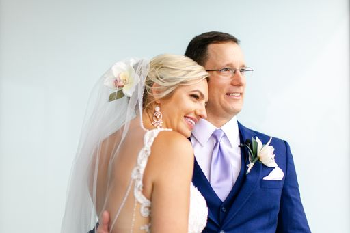 bride and groom posing for photos at the Opal Sands Resort on Clearwater Beach