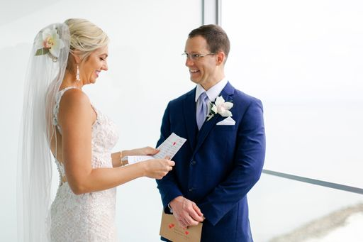 bride and groom reading the notes they have written for each other
