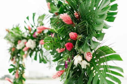 monstera leaves and tropical flowers in an Opal Sand Resort wedding structure on Clearwater Beach