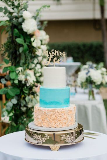 beautiful three tiered wedding cake with subtle beach colors