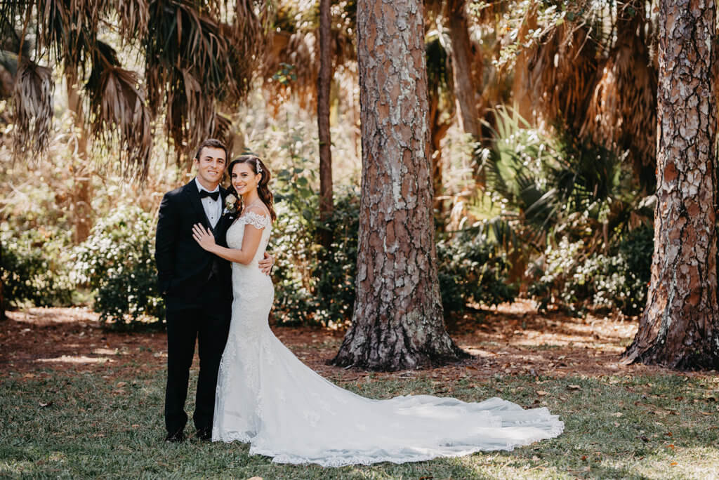 Saint Petersburg Florida Bride and Groom posing for photos in a downton park