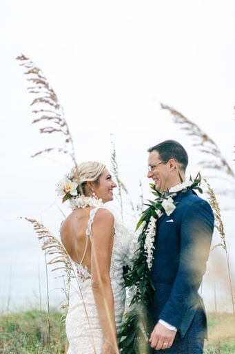 newlyweds wearing traditional Hawaiian wedding leis on Clearwater Beach