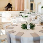 wedding reception inside the St. Petersburg Florida Women's Club with with and slate grey linens