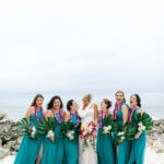 bride and bridesmaids in teal dresses on Clearwater Beach
