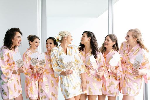 Clearwater Beach bride and her wedding part y in pineapple print robes