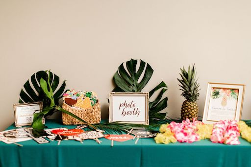 props, pineapples and Hawaiian inspired decor