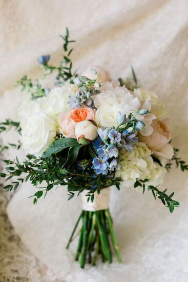 loose coral and blue bridal bouquet for a Clearwater Beach beach wedding